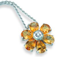 An Oval Citrine and Diamond Flower Pendant. 18ct White Gold.