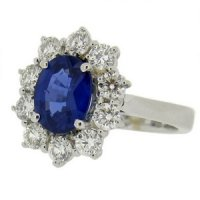 Amazing Oval Sapphire & Round Diamond cluster - 18ct White Gold