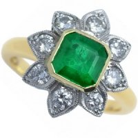 Octagonal Emerald and Diamond Floral Cluster Ring.