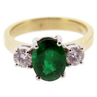 Simple Oval Emerald and Diamond Trilogy Ring.