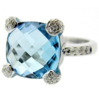 18 carat gold. A Blue Topaz and Diamond Ring.