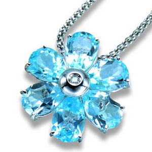 An 18K White Gold Blue Topaz and Diamond Flower Pendant. - Click Image to Close