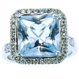 A White Gold Square Aquamarine and Diamond Cluster Ring.