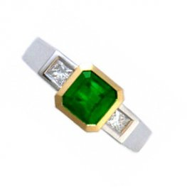 An Emerald-Cut Emerald & Diamond Three Stone Ring.