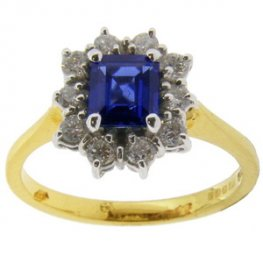 Emerald cut Sapphire and Diamond Traditonal Cluster Ring.