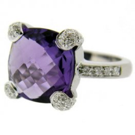 A Cushion Cut Amethyst and Diamond Ring. 18kt Gold.