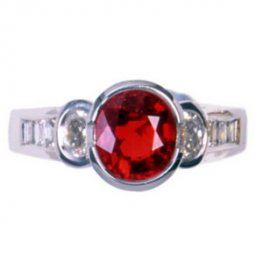 A White Gold Oval Ruby and Diamond Single Stone Ring. 18K.