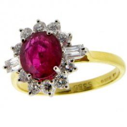 Oval Ruby and Diamond Cluster Ring. 18 karat Gold.
