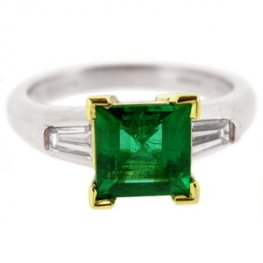 Square Emerald solitaire ring with baguette diamond shoulders.