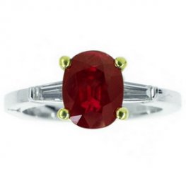 18k Ruby Solitaire ring with Baguette Diamond shoulders.
