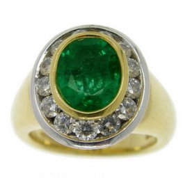Bold Oval Emerald and Diamond Cluster Ring. 18carat Gold