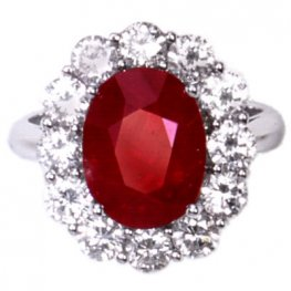 A White Gold Oval Ruby and Diamond Cluster Ring. 18kt.