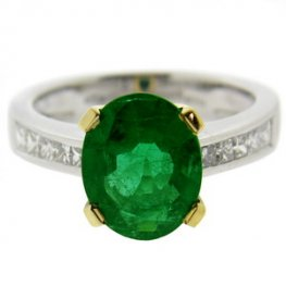Contemporary Oval Emerald ring with Diamond Shoulders. 18ct Gold