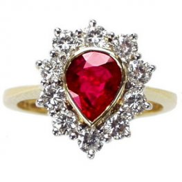 Pear shape Ruby & Diamond Cluster ring. 18 carat Gold.