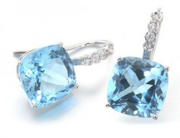A pair of Blue Topaz and Diamond Earrings white gold.