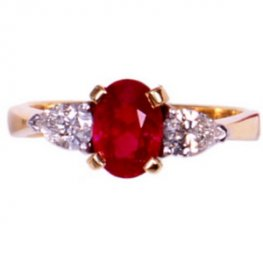 18ct Ruby Ring. An Oval Ruby and Diamond Three Stone Ring.
