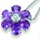An 18K White Gold Amethyst and Diamond Floral Pendant.