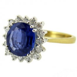 Stunning Cornflower Blue Cushion cut Sapphire and Diamond Ring.