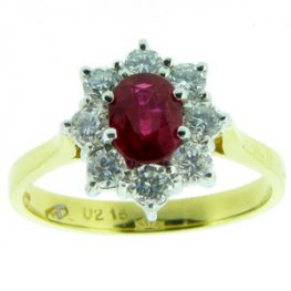Entrancing Oval Ruby and Diamond Cluster Ring. 18ct Gold