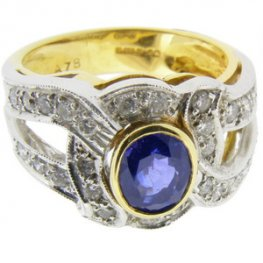 Fancy Sapphire and Diamond Single Stone Dress Ring. 18K - 750.