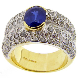 Contemporary Oval Sapphire and Pave Diamond Ring.
